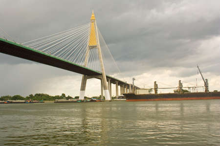 Rain was falling at the bridge over the river port of Thailand  photo