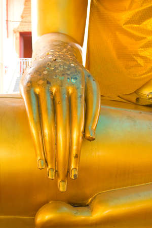 Hand worship the gold statue of the Maratha enemies faith in Buddhism  photo