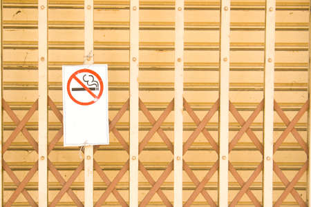 No smoking warning sign posted on the front door of the community  photo