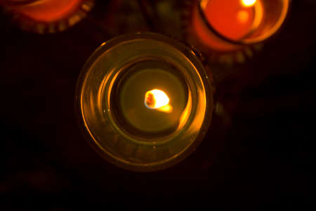 Light a candle in a small glass and colors. photo