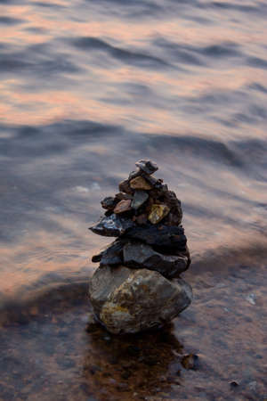 Placed stones stacked requires concentration and patience when faced with a wave of water to cultivate children photo