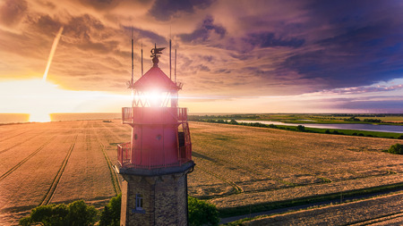 Lighthouse in Sunset with Storm