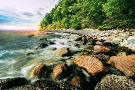 Stone coast in sunrise Stock Photo
