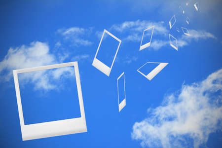 photo frame falling from blue sky photo