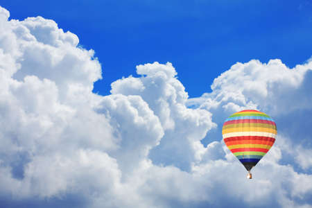 colorful hot air balloon on nice cloudy blue sky  photo
