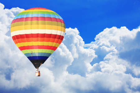 air view: colorful hot air balloon on nice cloudy blue sky