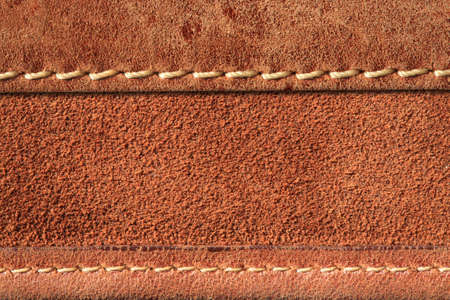 seam: brown leather with seam background.