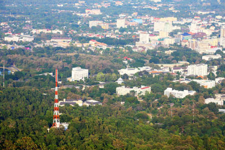satellite pole in jungle and city landscape , take from top view.  Stock Photo - 11385601