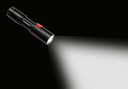 defuse: beam of a flashlight isolated dark bg.