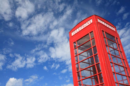 telephone box: red telephone box with blue sky. Stock Photo