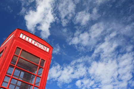 red telephone box with blue sky. Stock Photo - 11835964