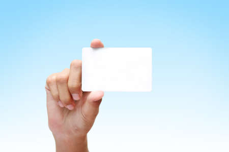 female hand holding white business card photo