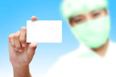 Stock Photo  female holding blank business card in hand  photo