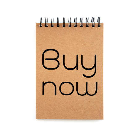 marked down: buy now copy on brown book isolated white   Stock Photo