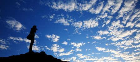 Photographer taking photo on highest mountain view Stock Photo - 12999753