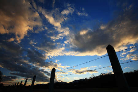silhouette fence with blue sky photo