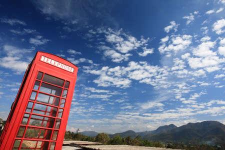 vintage Telephone box with blue sky  photo