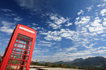 vintage Telephone box with blue sky  photo
