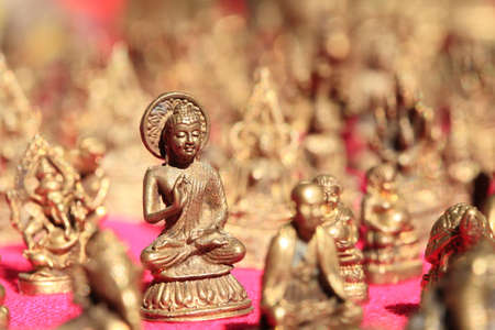 praye: Buddha statue stacks on table