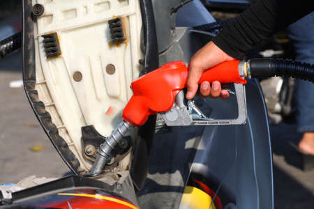 Petrol - refill fuel to motorcycle   photo