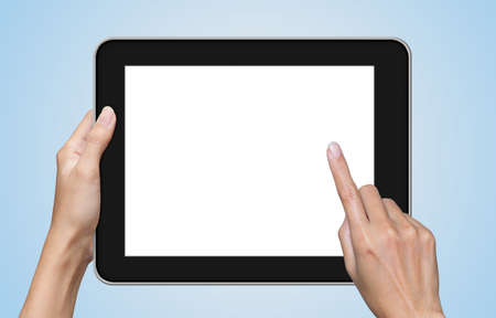 tablet pc in hand: hand touch screen on tablet pc