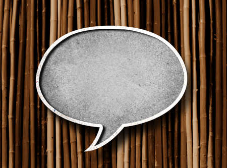 speech bubble text box on wooden background  photo