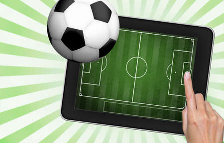 hand touch tablet pc  screen with soccer Stock Photo - 13189858