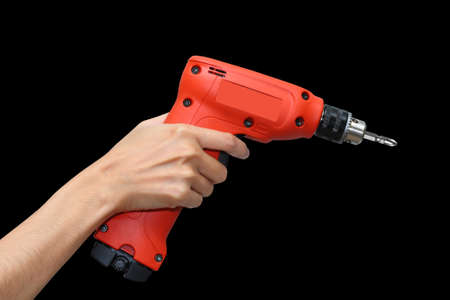 hand holding red electric drill photo