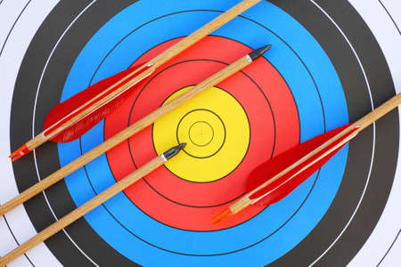 threesome: arrows focus to archery target