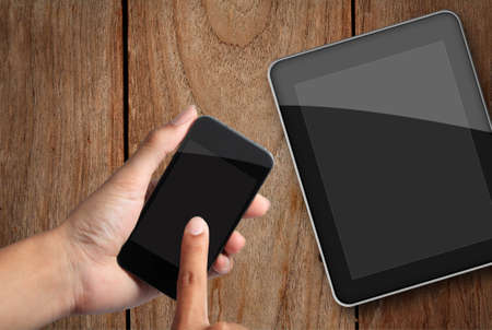 hand touch screen on smart phone and tablet pc  photo