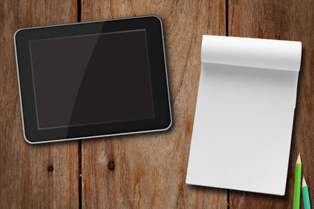 tablet pc  vs notepad paper  photo