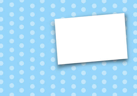 card on light blue polka dot background. photo