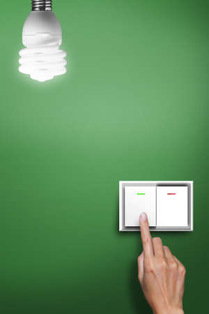 electricity supply: hand pressed to switch to turn on the light.