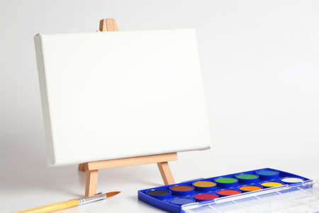 Eeasel with brush and watercolors Stock Photo - 14344836