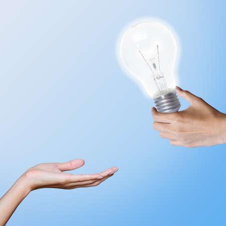 intelligent partnership:  bulb, transfer idea from hand to hand