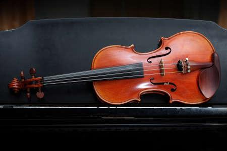 violin on black piano  photo
