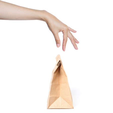 famale: famale hand picking paper bag