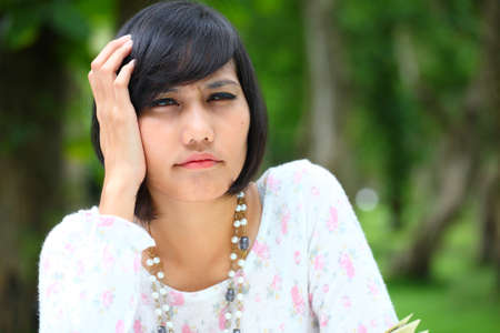 female head ache with nice green background Stock Photo - 14705306