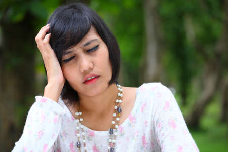 female head ache with nice green background  photo