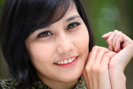 freigestellt: asian female smiling park-outdoor  Stock Photo
