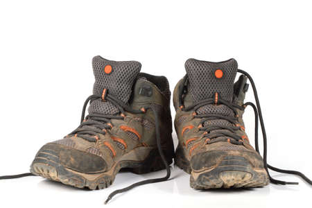 muddy clothes: shoe, trekking boots Stock Photo