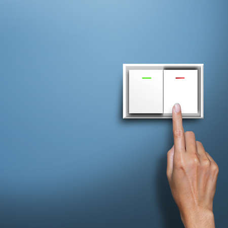 save electricity: hand pressing electronic-light switch Stock Photo