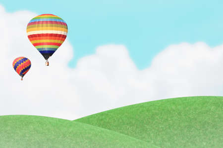 hot air Ballons over grass hill and blue sky  photo