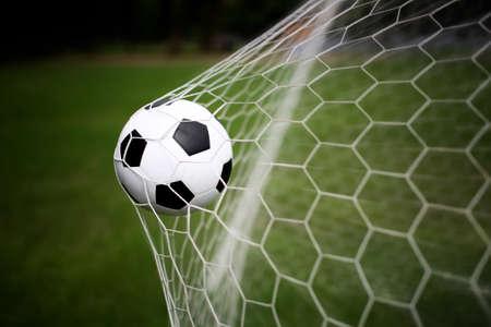 recreational sports: soccer ball in goal Stock Photo