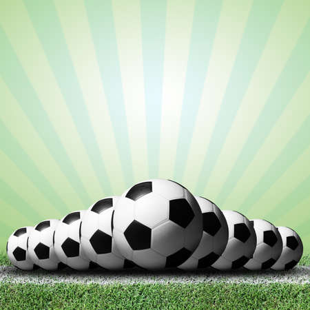 Soccer balls with green rays background  photo