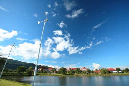 global village: wind turbine white lake,town view  Stock Photo