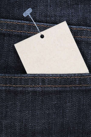 clothing tag: blue jeans and blank paper price tag Stock Photo