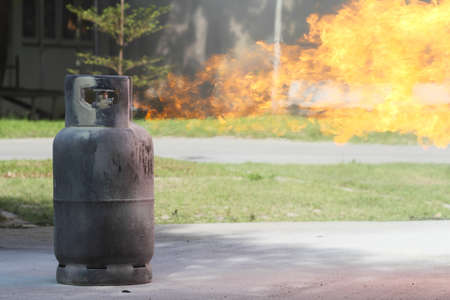 gas fire: Fire burning over Gas container  Stock Photo