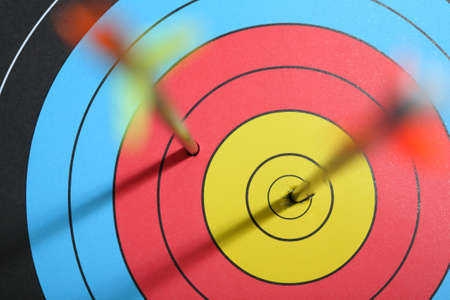 failed attempt: arrow hit target, one hit bull Stock Photo