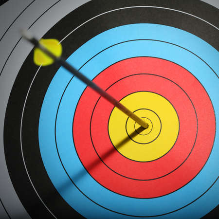 Arrow hit goal ring in archery target  Stock Photo - 15794729